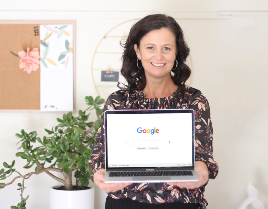 Amy with laptop on the Google Search Screen